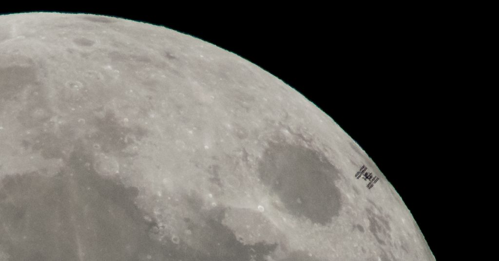 International Space Station against the Moon