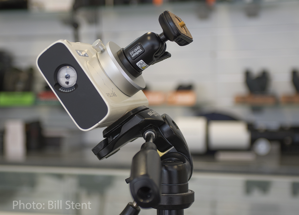The complete Built-in compass and polar alignment hole on the Vixen Polarie assembly on a tripod